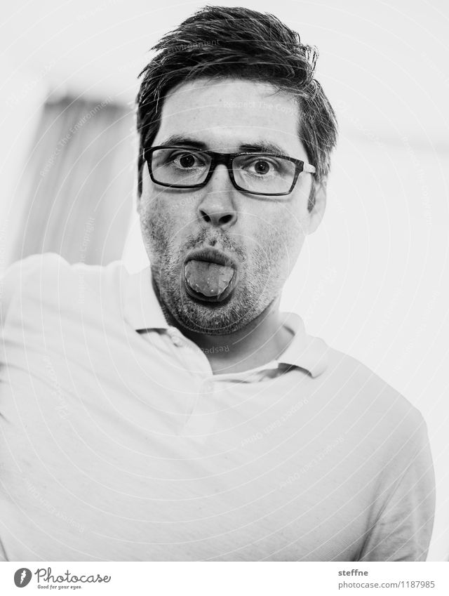 without words Masculine Man Adults 1 Human being 30 - 45 years Gray Funny Childlike Tongue Person wearing glasses polo shirt Black & white photo Interior shot