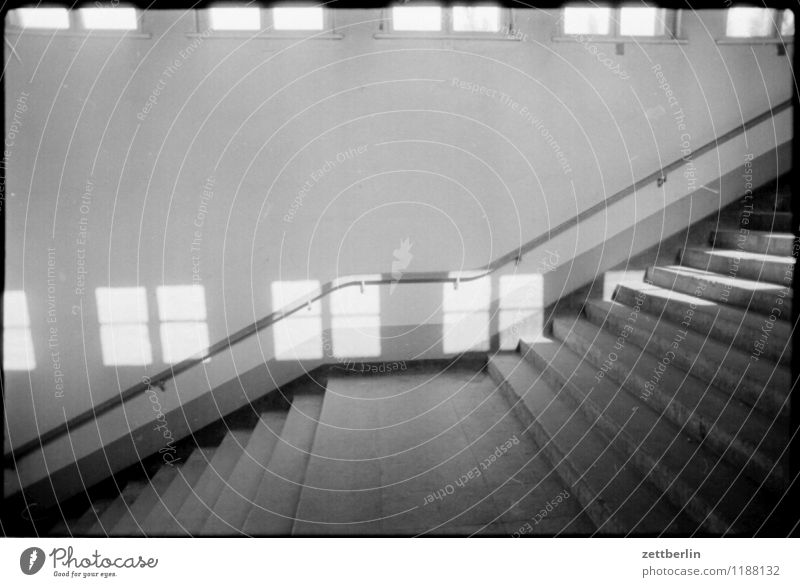 Hohen Neuendorf, 1984 Stairs Level Landing Black & white photo Sun Window Light Shadow Handrail Banister Go up Descent Copy Space Copy Space top