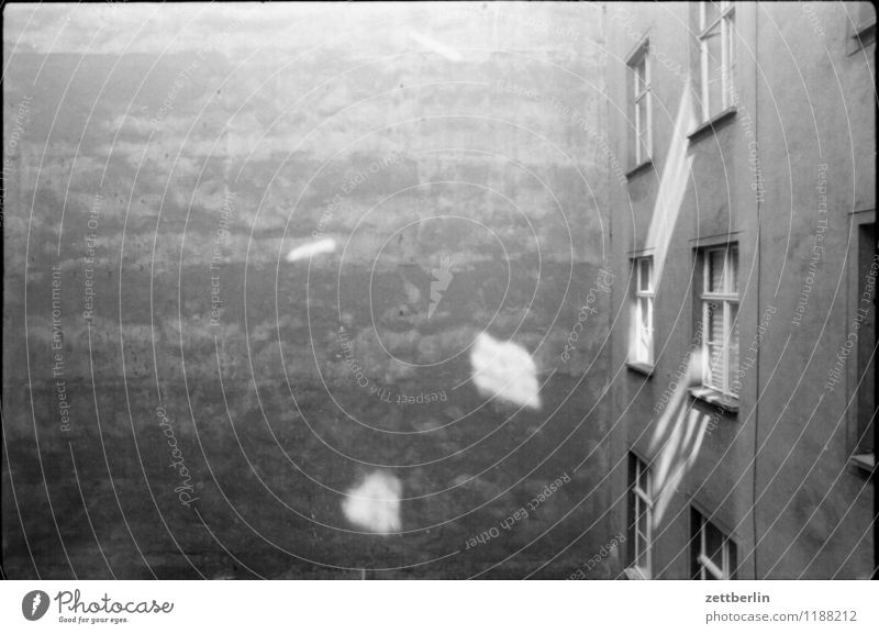 Prenzlauer Berg, 1984 Black & white photo Gray Gloomy Sadness Courtyard Backyard Interior courtyard Wall (barrier) Fire wall Old building Window
