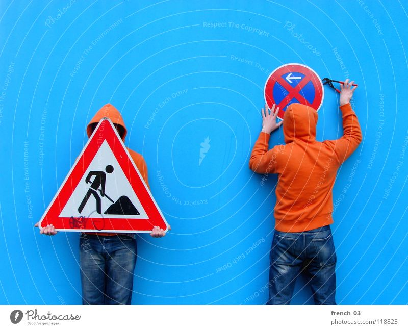 Human being Man Blue Hand White Beautiful Red Colour Wall (building) Wall (barrier) Orange Germany Work and employment Going Arm Signs and labeling