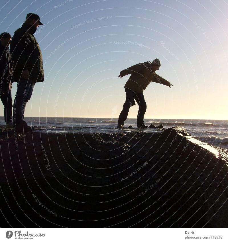 BEFORE THE JUMP Joy Contentment Vacation & Travel Summer Beach Water Beautiful weather Rock Coast North Sea Observe Jump Stand Smoothness Denmark Reflection