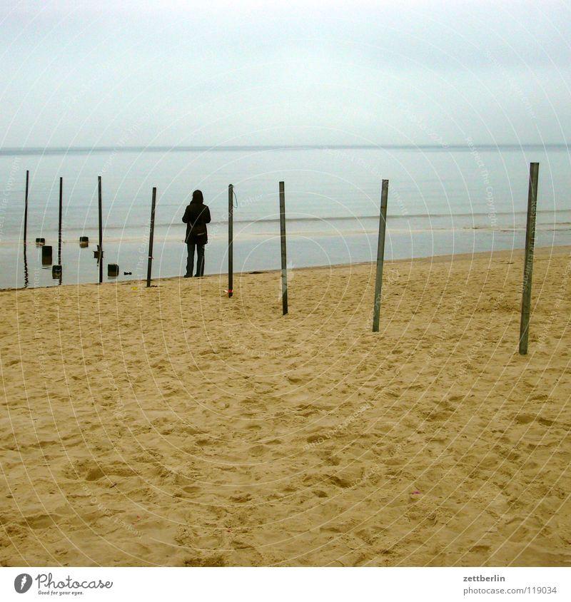 frontier Ocean Beach Coast Horizon Far-off places Man Woman Loneliness Longing Fog Sandbank Sea water Tidal barrier Break water Border Europe Human being