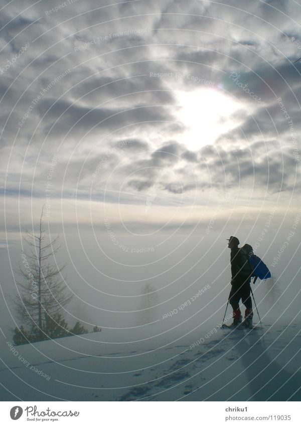 Human being Man Loneliness Calm Clouds Winter Mountain Snow Fog Hiking Alps Climbing Mountaineering Winter sports Snow track Snow shoes