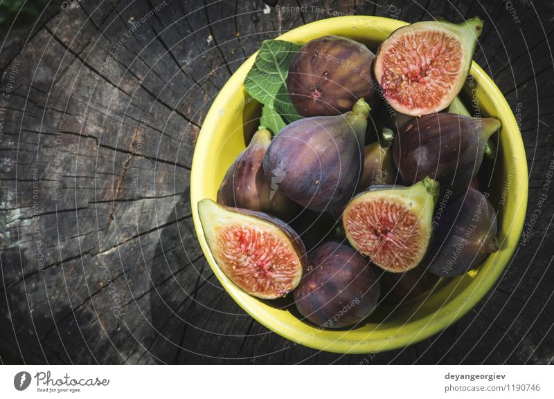 Figs in yellow bowl Nature Autumn Natural Fruit Fresh Nutrition Table Exotic Dessert Bowl Slice Juicy Ingredients Rustic Raw Tropical