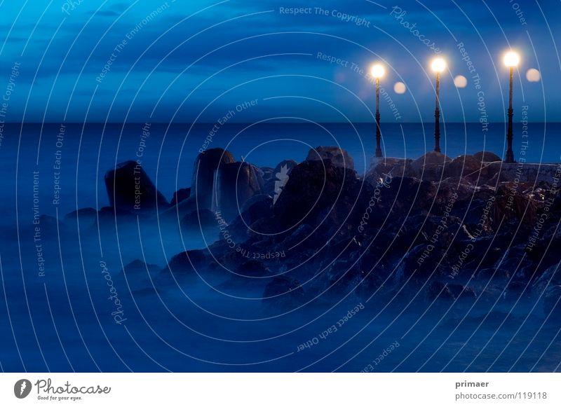 sea atmosphere Ocean Moody Dusk Twilight Night Light Lantern Clouds Sky blue Waves Far-off places Loneliness Slowly Calm Beach Coast Footbridge Grief Caresses