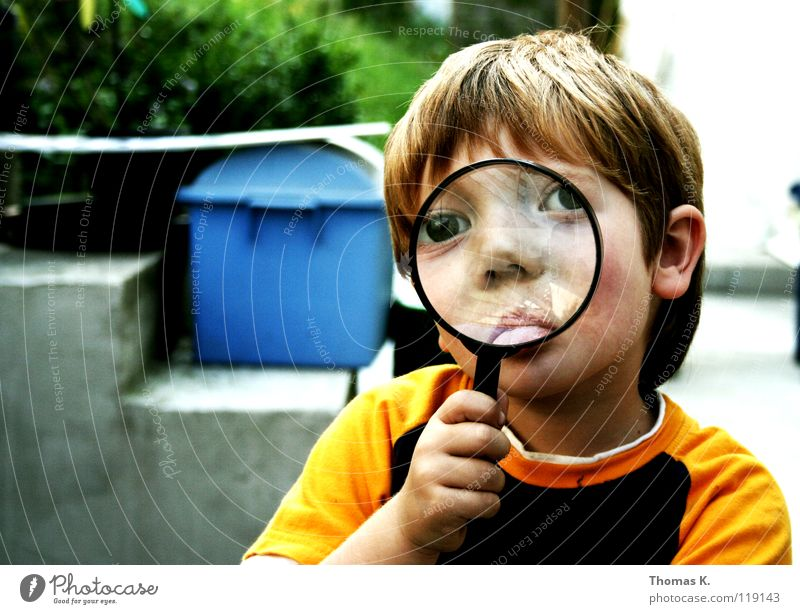 Through The Looking Glass II Child Boy (child) Enlarged Hand Eyeglasses Suspect Portrait photograph Investigate National security Tracks Reading Search