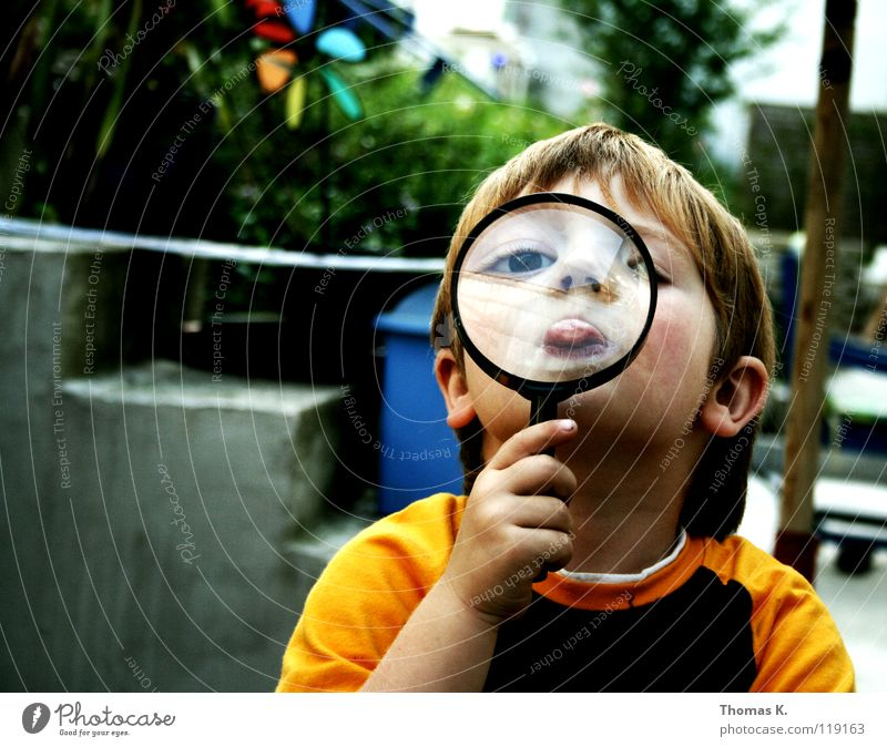 Through The Looking Glass III Child Boy (child) Enlarged Hand Eyeglasses Suspect Portrait photograph Investigate National security Tracks Reading Search