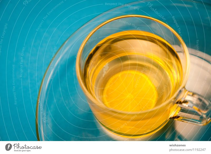 Lemon Tea in a Glass with blue Background Fasting Beverage Plate Cup Healthy Wellness Harmonious Well-being Yellow cup of tea lemon tea Blue Blue background