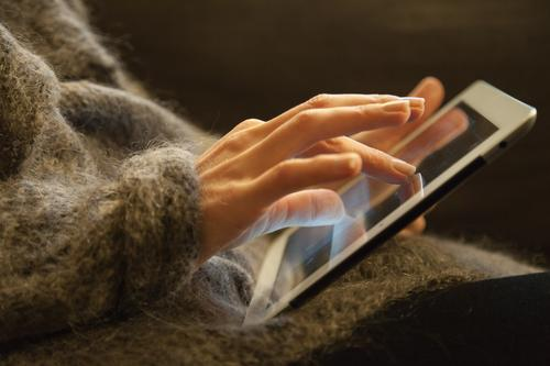 Woman Hands working on a Touch Pad PDA Computer Notebook Information Technology Internet Feminine Fingers 30 - 45 years Adults Sweater Jacket Movement