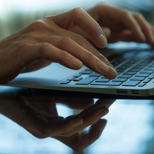 Hands typing on the Keyboard of a Laptop Education Adult Education Office work Business Computer Notebook Internet Write Woman Typing Women`s hand Reflection