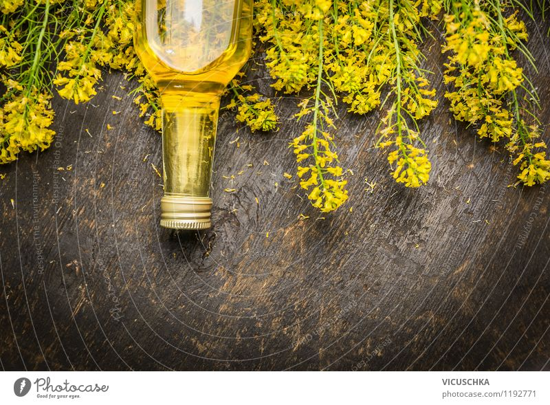 Rapeseed oil in glass bottle with fresh rape blossoms. Food Herbs and spices Cooking oil Nutrition Organic produce Vegetarian diet Diet Style Design