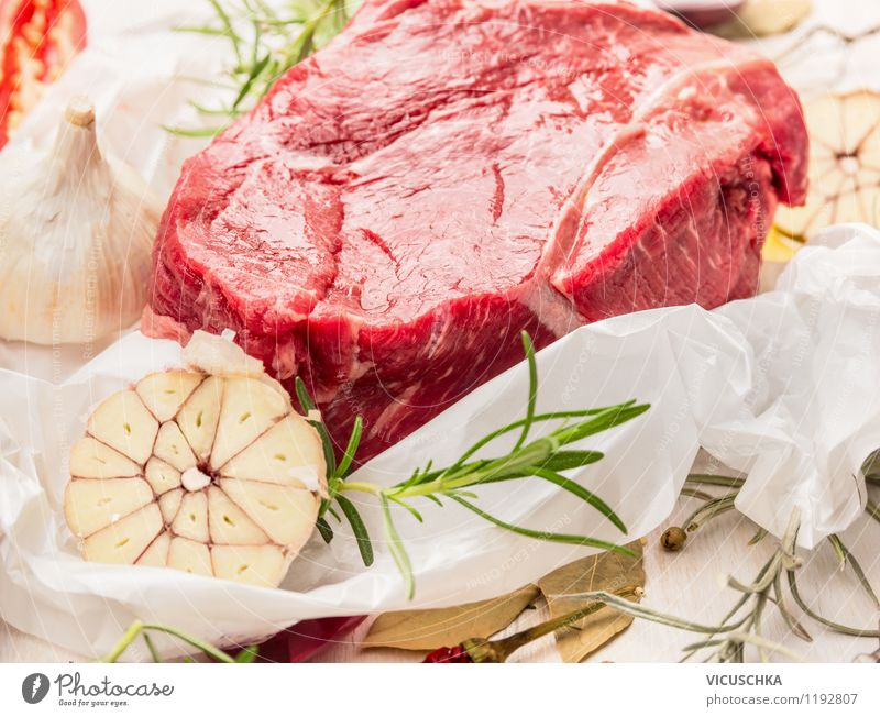 piece of raw fillet of beef with herbs and spices on paper Food Meat Herbs and spices Nutrition Lunch Dinner Buffet Brunch Organic produce Diet Healthy Eating
