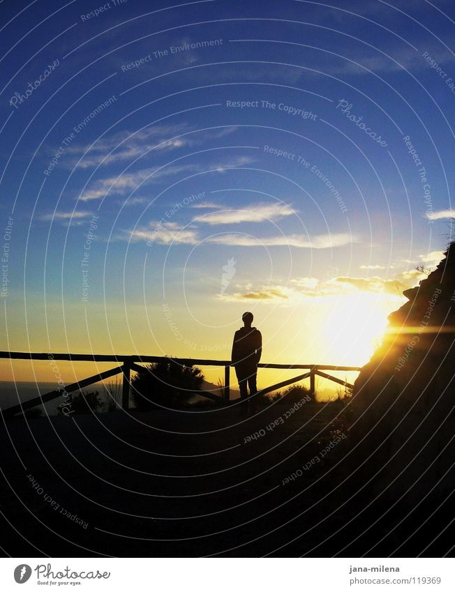 Human being Man Beautiful Sky Sun Ocean Blue Beach Vacation & Travel Black Clouds Dark Mountain Bright Lighting Coast