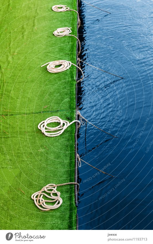 investment opportunity Water Deserted Harbour Navigation Rope Round Blue Green Jetty Artificial lawn Colour photo Exterior shot Day Deep depth of field