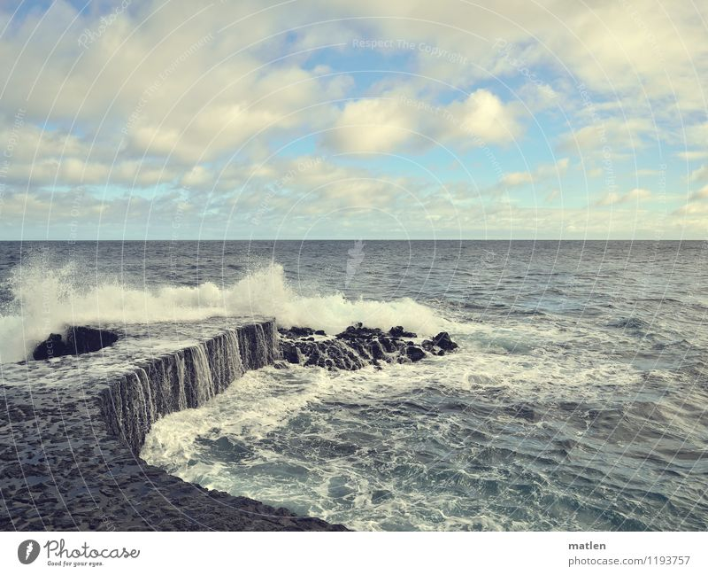 splash Nature Landscape Sky Clouds Horizon Sun Weather Beautiful weather Waves Coast Ocean Wall (barrier) Wall (building) Maritime Wet Blue Gray Colour photo