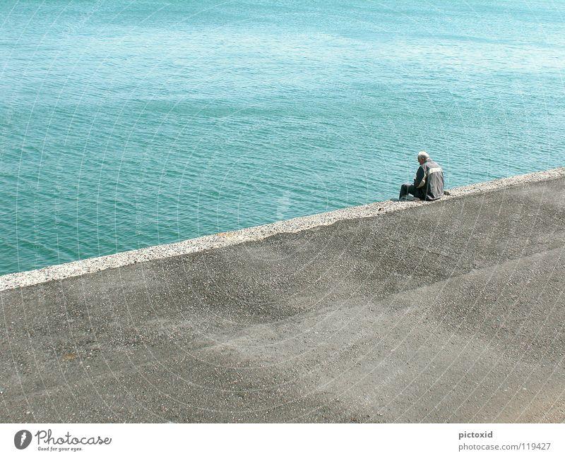Man Water Ocean Blue Vacation & Travel Calm Loneliness Contentment Wait Concrete Time Future Vantage point Harbour Serene Past