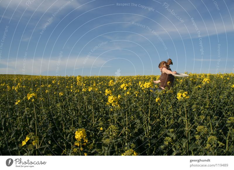 Franzi goes yellow Field Canola Canola field Yellow Green Summer Clouds Meadow Playing Girl Woman Mecklenburg-Western Pomerania Joy Blue Sky Walking run away