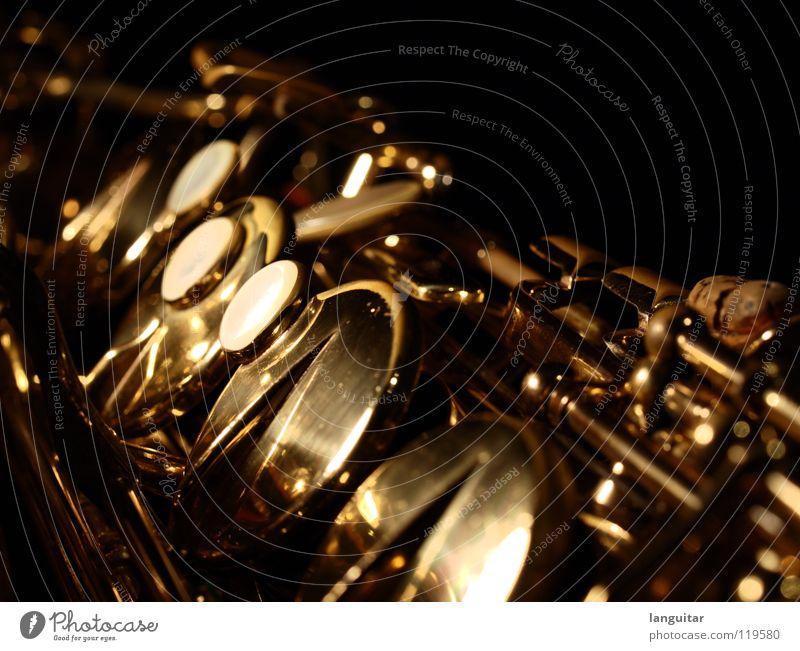 Joy Dark Playing Music Metal Glittering Gold Exceptional Wind instrument Musical instrument Swing Jazz Blues Mechanics Flap Saxophone