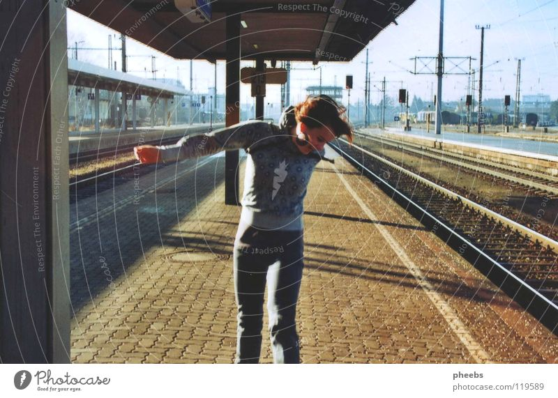 peace, joy, station. Woman Railroad tracks Platform Light Meadow Jump Hop Joy Train station Signs and labeling Shadow Earth Sky Paving stone Passenger