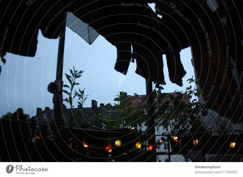 dark evening_2 Town House (Residential Structure) Balcony Dark Moody Loneliness Idyll Life Nostalgia Sadness Living or residing Light Fairy lights Clothesline