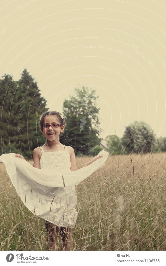 summertime Child Girl 1 Human being 3 - 8 years Infancy Nature Landscape Meadow Dress Eyeglasses Hair and hairstyles Braids Playing Authentic