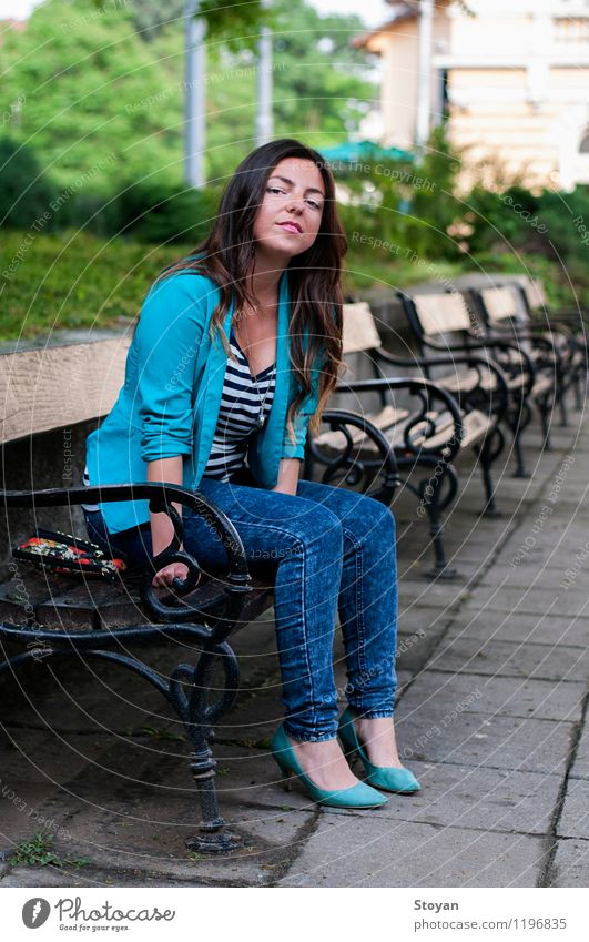 A young woman sitting on a garden bench Youth (Young adults) City Plant Beautiful Young woman Tree Eroticism 18 - 30 years Adults Life Stone Fashion Metal Park Elegant Footwear
