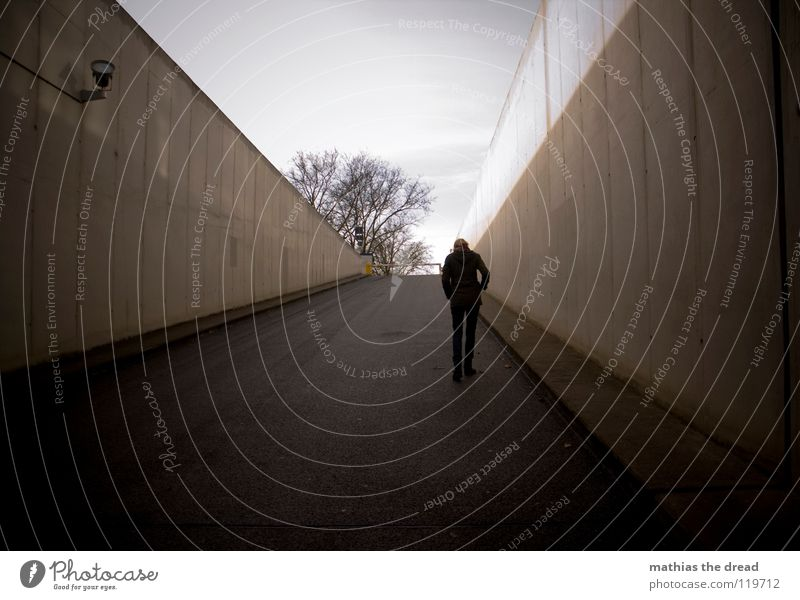 LONELY WALK Winter Dreary To go for a walk Going Loneliness Gray Incline Dark Threat Black Concrete Tunnel Facade Cast iron Asphalt Highway ramp (entrance)