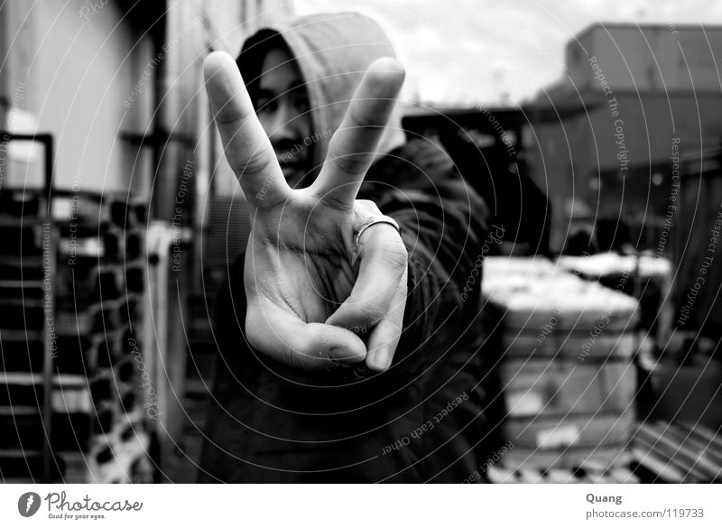 angle view Peace Matrimony Hooded (clothing) Hand Fingers Wedding band Exterior shot Black & white photo Man Corner Circle Freedom