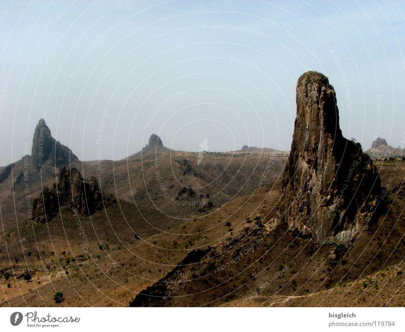 Calm Loneliness Far-off places Mountain Landscape Large Rock Africa Desert Hill Badlands Sparse Lunar landscape