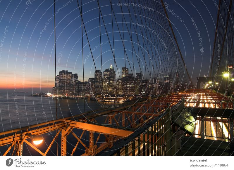 Sky Water City Far-off places Dark Lighting Transport Bridge USA River Steel cable Skyline Americas Jetty Downtown Dusk