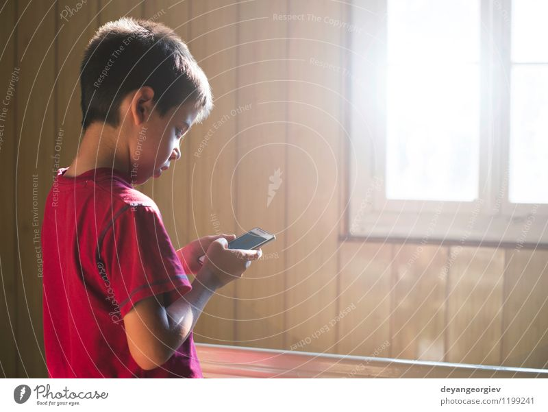 Child playing with mobile phone Human being White Joy Boy (child) Playing Small School Infancy Technology Cute Telephone Smart PDA Caucasian