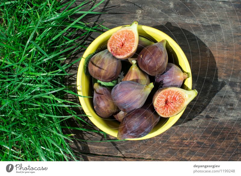 Figs in yellow bowl Fruit Dessert Nutrition Bowl Exotic Table Nature Autumn Fresh Natural Juicy food figs Rustic sweet wood Raw wooden healthy ripe Organic