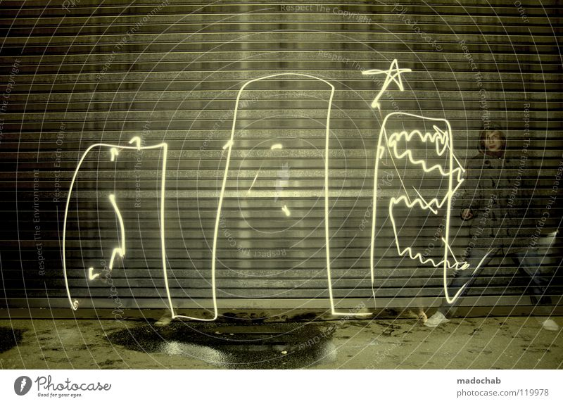 Human being Man Youth (Young adults) Dark Wall (building) Graffiti Art Lighting Star (Symbol) Lifestyle Stand Illuminate Creativity Draw Past Trashy