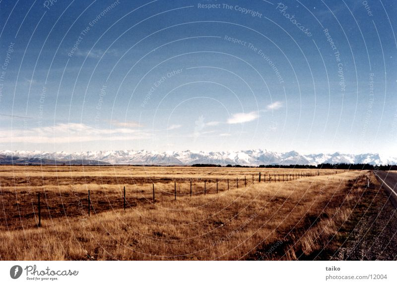 Sky Blue Clouds Loneliness Yellow Far-off places Snow Grass Mountain Brown Alps Peak Dry Pasture Australia Steppe
