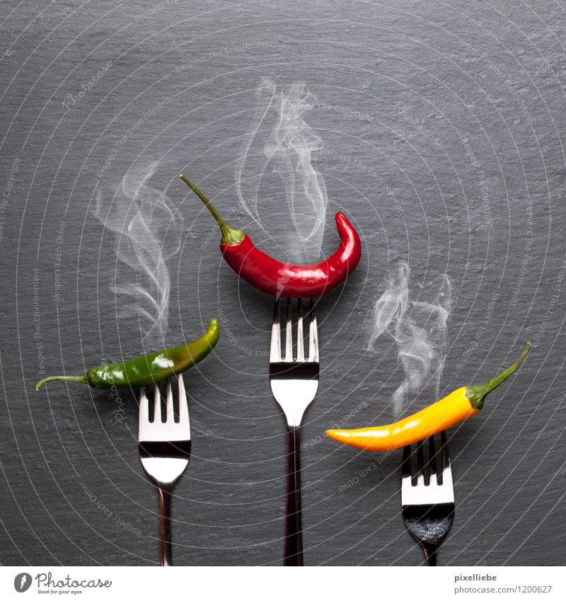 Steaming coloured chili peppers Food Vegetable Herbs and spices Nutrition Eating Vegetarian diet Diet Italian Food Cutlery Fork Exotic Healthy Healthy Eating
