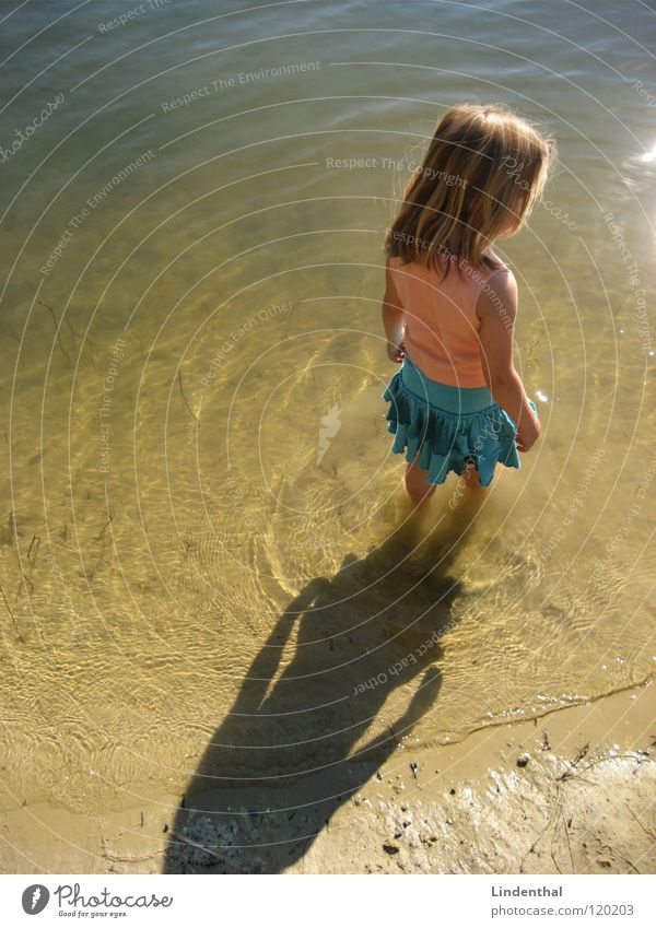 Me and the lake Child Girl Stand Lake Beach Wet Dress Turquoise Top Water Calm sea river Feet sun