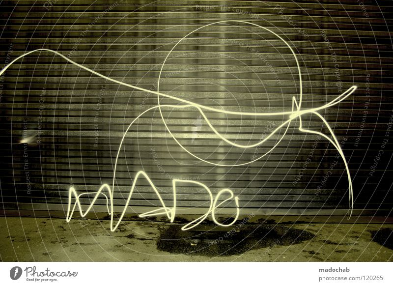 MADO Man Stand Wall (building) Loneliness Light Street art Night Campaign Lifestyle Temporary Illegal Dark Spray Spontaneous Cold Time travel Present Day Past