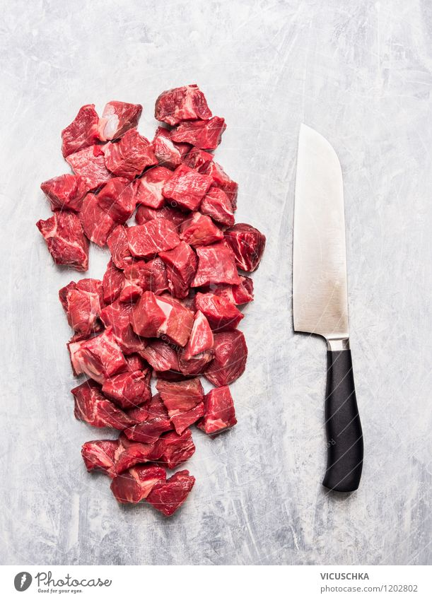 Meat cubes and knives Food Nutrition Organic produce Knives Style Design Healthy Eating Table Kitchen Cook cut Cube Goulash Raw Food photograph Meat-eater