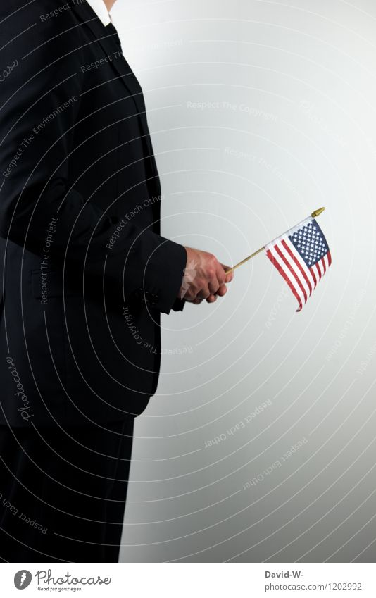 Man holds American flag in hand Science & Research Study Economy Trade Media industry Financial Industry Business Career Success To talk Human being Masculine