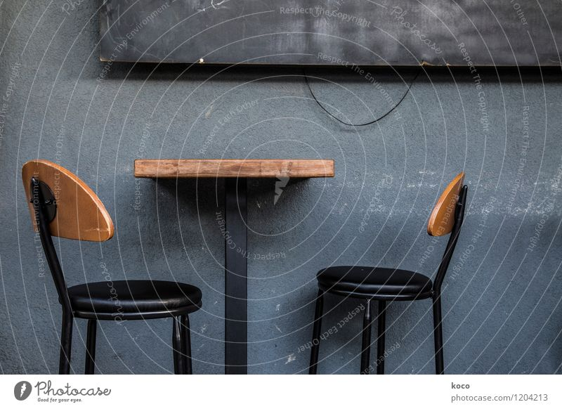 take a seat. Wall (barrier) Wall (building) Facade Table Chair Armchair Signs and labeling Wait Dark Retro Trashy Gloomy Blue Brown Gray Black Loneliness