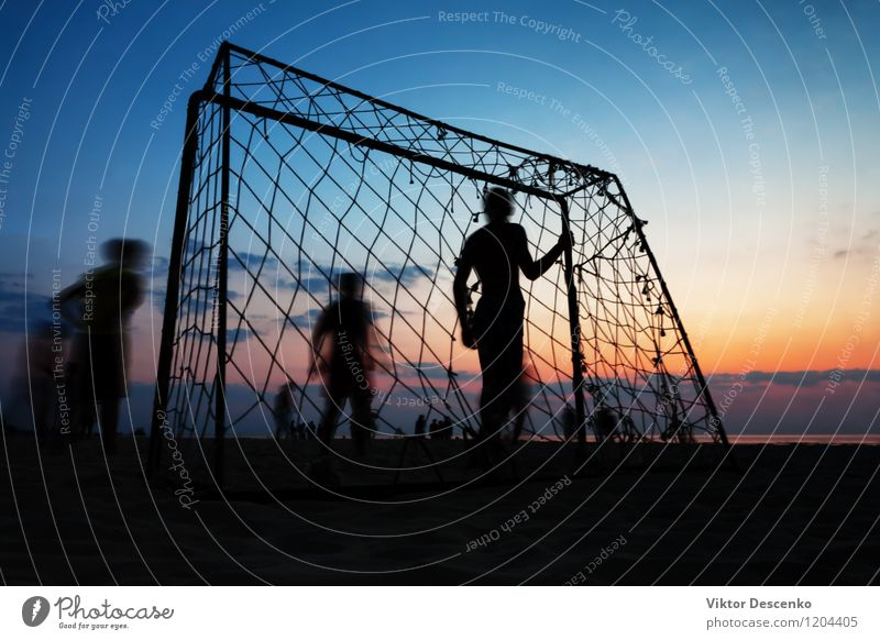 Boys play football at the gate on the summer beach at sunset Sky Youth (Young adults) Man Summer Sun Ocean Landscape Joy 18 - 30 years Beach Adults Boy (child)