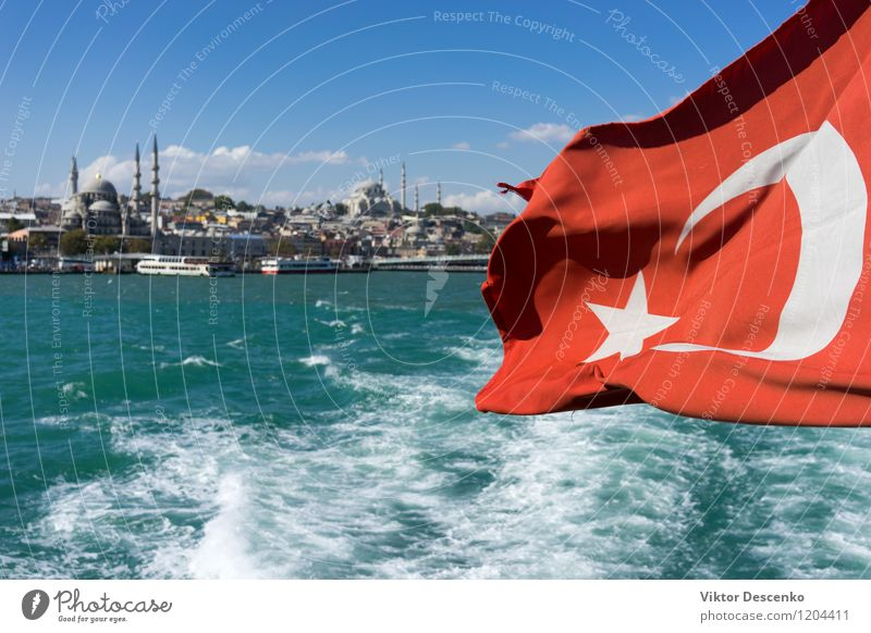 View of Istanbul from the ferry with a flag in the wind Vacation & Travel Tourism Summer Ocean Culture Landscape Wind Town Skyline Building Architecture Ferry