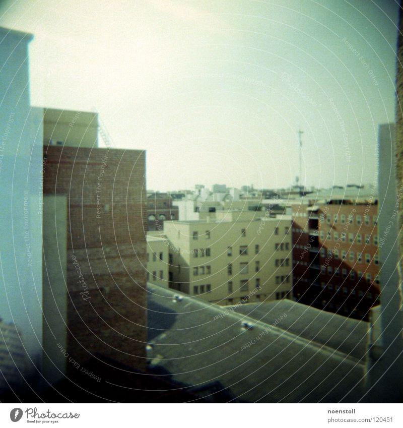 view in madrid Vantage point Town Madrid Antenna Roof Tar paper Wall (building) Brick Window Glazed facade Frontal High-rise Holga Vignetting Medium format