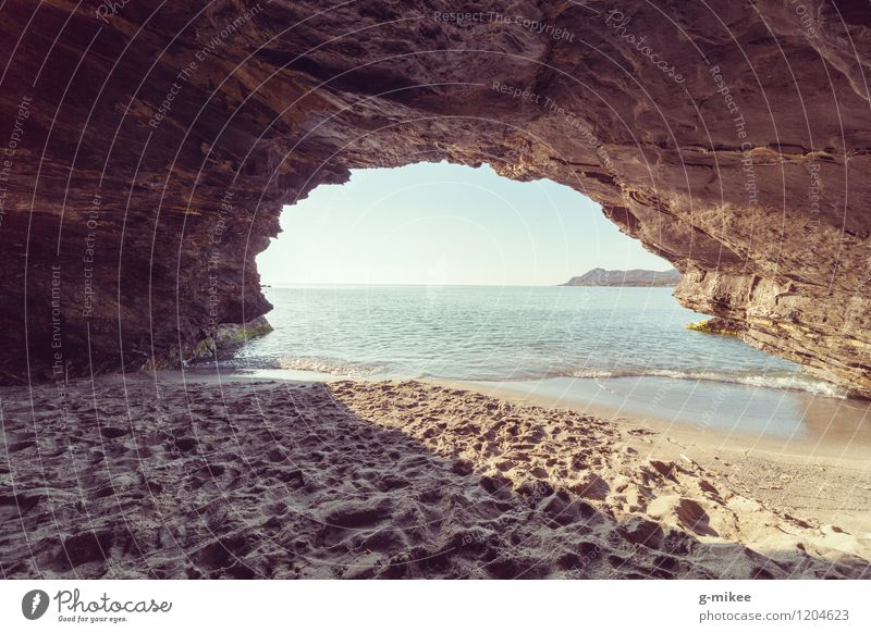 Cave at the beach Nature Sand Air Water Sky Summer Beach Ocean Island Warmth Blue Yellow Mysterious Hiding place Vantage point Uniqueness Colour photo