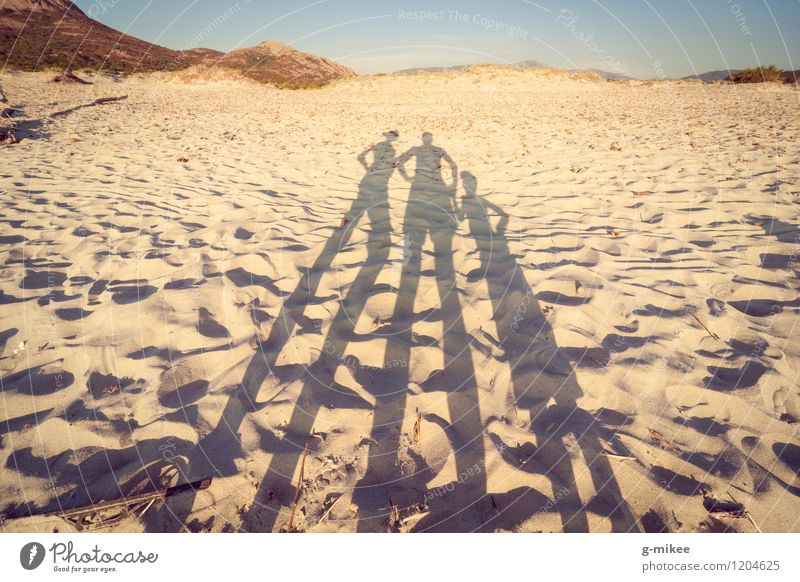 Family on the beach Human being Family & Relations Partner 3 Group Nature Landscape Sand Sunlight Summer Beach Island Together Warmth Yellow Colour photo