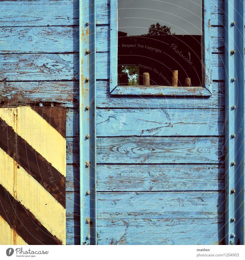 WINDOW BOARD Window Transport Logistics Train travel Rail transport Railroad Old Wait Blue Yellow Black construction wagon Wooden wall Colour photo
