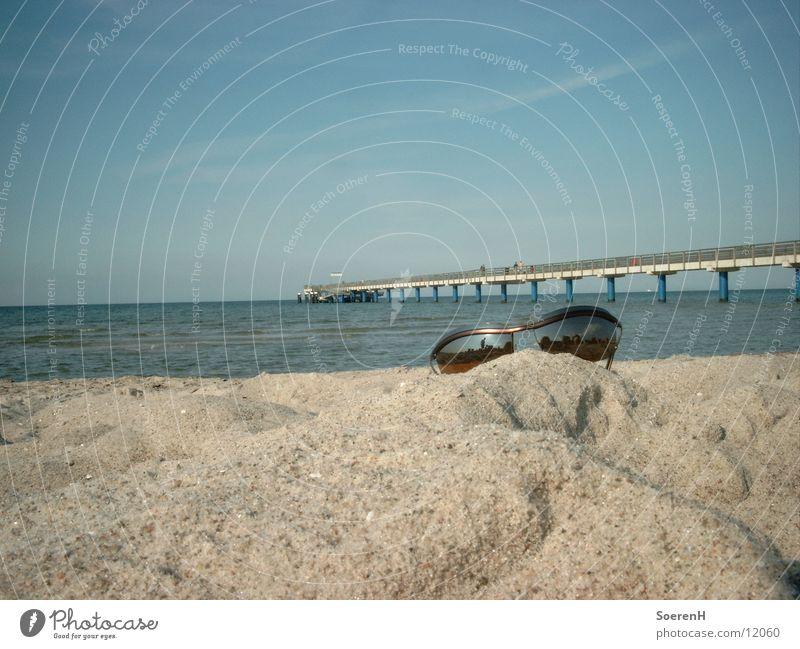 product placement Sunglasses Beach Footbridge Eyeglasses Ocean Leisure and hobbies Water Sand Sky