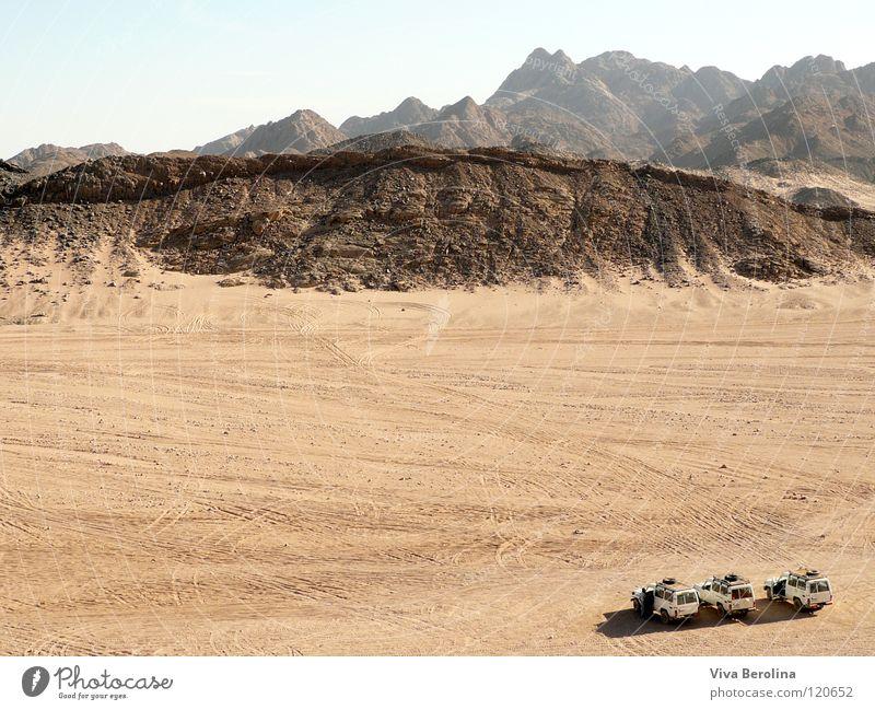ski jump Offroad vehicle Horizon Tracks Infinity Far-off places Large Small Vacation & Travel Egypt Safari Desert jeep jeeps Sand Freedom Mountain Sky Car