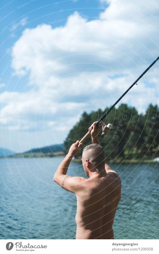 Man on fishing with rod Lifestyle Relaxation Leisure and hobbies Vacation & Travel Summer Sports Human being Adults Nature Landscape Sky Lake River Watercraft