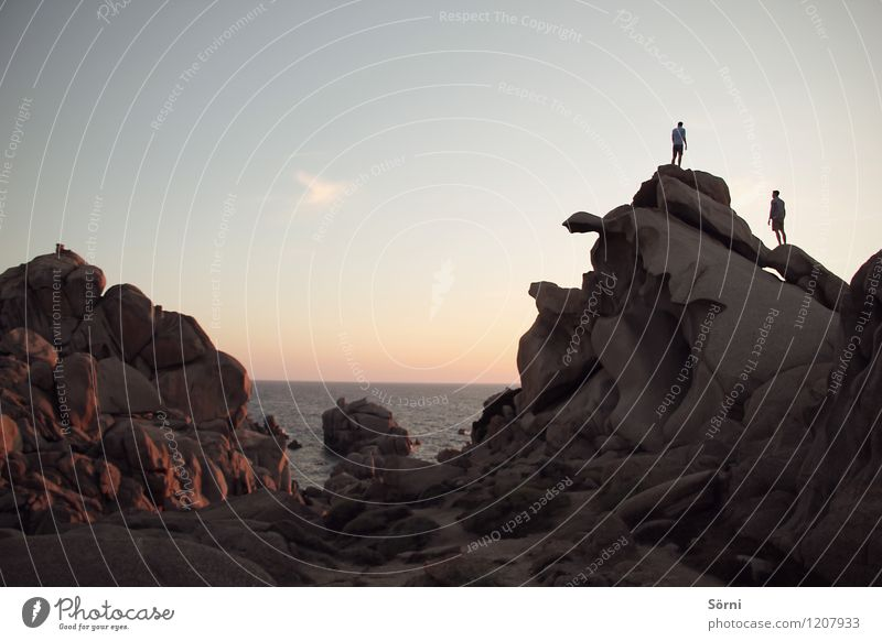 Human being Youth (Young adults) Ocean Landscape Far-off places 18 - 30 years Beach Adults Mountain Coast Freedom Rock Friendship Masculine Power Hiking